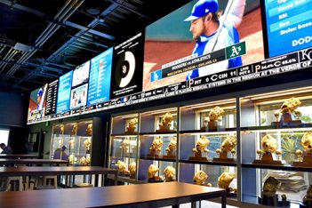 LED boards and Gold Gloves in the Gold Glove Bar at Dodger Stadium.