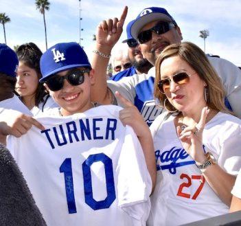 Justin Turner fans holding his number 10 jersey.